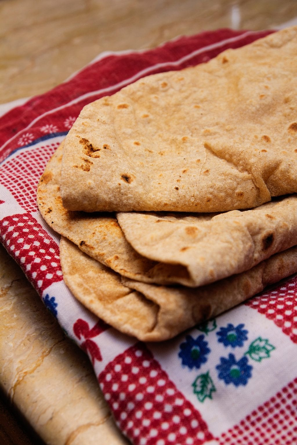 butter naan indian bread folded on cloth snack lunch warm flatbread