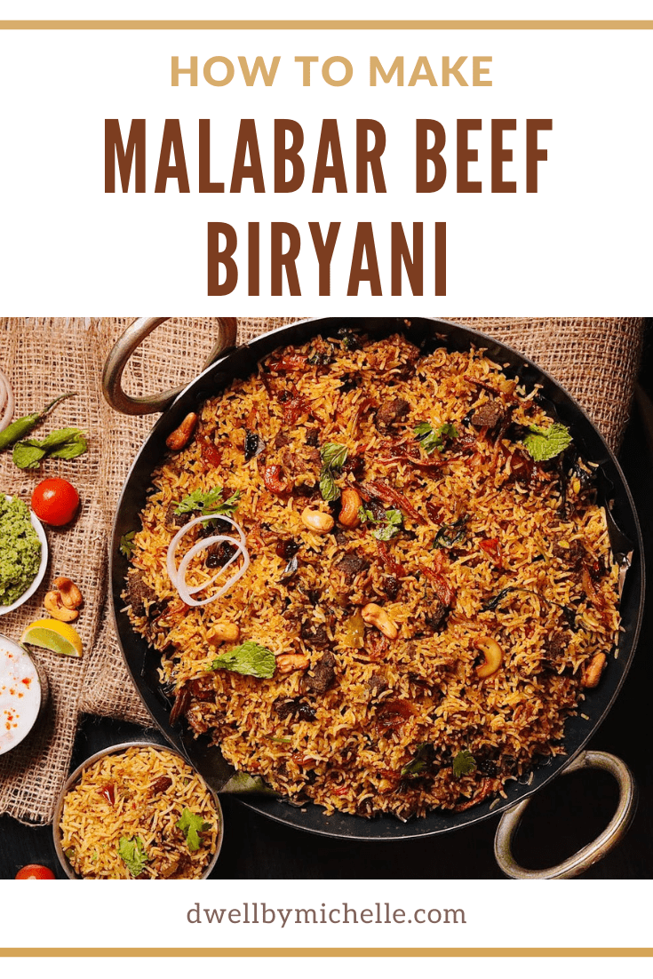 Indian beef biryani in large pot with basmati rice, spices