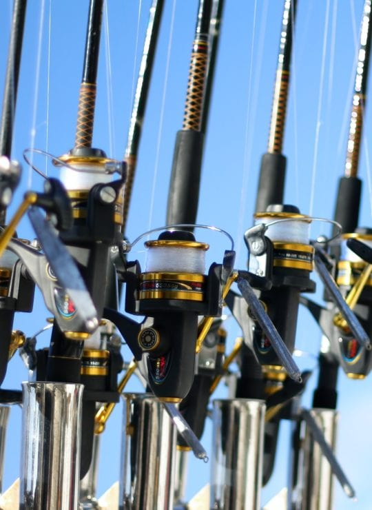 best travel fishing rod, various rods in a boat on the ocean