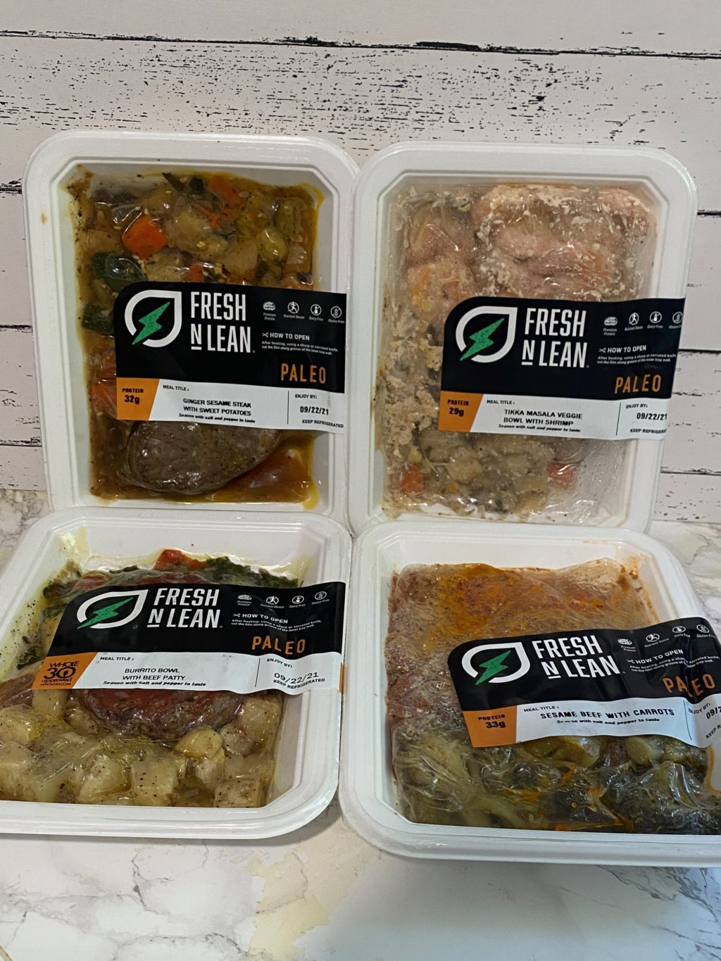 Fresh N Lean Review: Fresh N' Lean Meals: Ginger Sesame Steak with Sweet potatoes, tikka masala veggie bowl with shrimp, burrito bowl with beef patty, and sesame beef with carrots